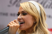 Paris Hilton attended the Platinum Rush fragrance launch sporting a retro-glam cat eye.