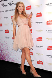 Paris Hilton looked ultra girly, as always, in a blush-hued baby doll dress at the launch of her new fragrance in Sydney.