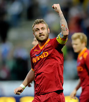 Futbol star Daniele de Rossi has major love of ink! On the field in Parma, Italy, Daniele showed off his budding sleeve tattoo, composed of animals, people and angels. Inked in dark blue, Daniele's tattoo has pops of bright orange and hot pink.