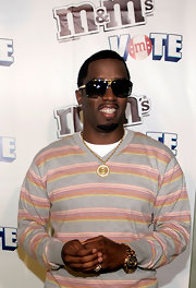 Diddy rocked a two-toned, chronograph watch that complemented his stylish shades.