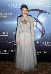 Jennifer Lawrence was cute and cozy in a star-print crewneck sweater by Dior at the 'Passengers' Paris photocall.