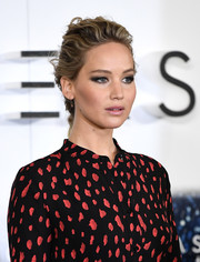 Jennifer Lawrence looked stylish wearing this messy French braid at the 'Passengers' photocall.