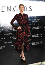 Jennifer Lawrence attended the 'Passengers' photocall wearing a red and black handkerchief-hem print dress by Proenza Schouler.