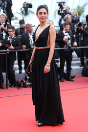 Golshifteh Farahani looked sultry in a black cowl-neck Grecian gown at the Cannes premiere of 'Paterson.'