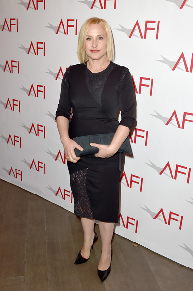Patricia Arquette Leather Clutch [clothing,dress,joint,shoulder,fashion,footwear,little black dress,knee,cocktail dress,ankle,beverly hills,four seasons hotel,los angeles,california,afi awards,arrivals,patricia arquette]