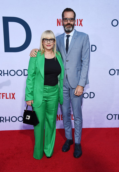 Patricia Arquette Buckled Purse [red carpet,green,carpet,suit,premiere,event,flooring,pantsuit,formal wear,outerwear,patricia arquette,eric white,photo call,california,hollywood,egyptian theatre,netflix,otherhood,l,photo call]
