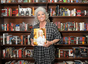Paula Deen wore a plaid button down blouse at a book signing.