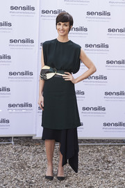 Paz Vega went ultra modern in a dark green dress with an asymmetrical black skirt underlay and a patchwork belt for her presentation as the new Sensilis ambassador.