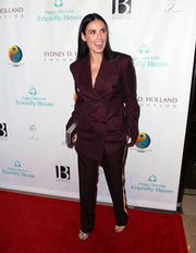 Demi Moore teamed her suit with a silver box clutch.
