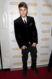 Justin Bieber wore a black crushed velvet blazer for the Pencils of Promise Charity Gala.