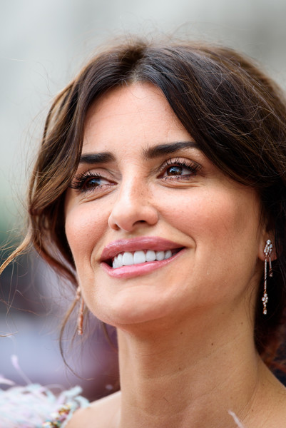Penelope Cruz Dangling Crystal Earrings [face,hair,eyebrow,skin,lip,facial expression,chin,smile,nose,hairstyle,red carpet arrivals,penelope cruz,film4 summer screen,pain and glory,uk,somerset house,england,gala,premiere,gala]