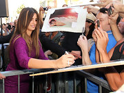Penelope Cruz signed autographs for her fans wearing a 9-carat heart shaped diamond eternity band set in platinum.