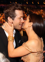 Sandra Bullock's wrist sparkled at the People's Choice Awards with a gold cuff bracelet.