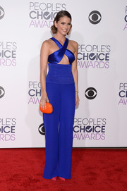 Shelley Hennig was bold with colors, pairing her blue outfit with a bright orange clutch by Jeffrey Levinson.
