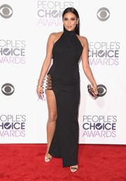 Shay Mitchell turned up the heat in a black Haney halter gown with a hip-grazing slit at the People's Choice Awards.