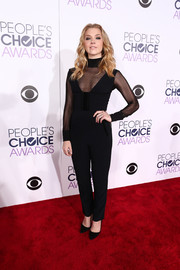 In a sea of dresses at the People's Choice Awards, Natalie Dormer was a standout in her sheer-panel black Roland Mouret jumpsuit.