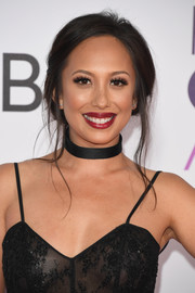 Cheryl Burke attended the 2017 People's Choice Awards wearing her hair in a messy-sexy updo.