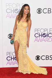 Jamie Chung's green Edie Parker clutch contrasted nicely with her yellow dress.