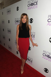 Allison Janney paired her turtleneck with a red pencil skirt for a more stylish finish.