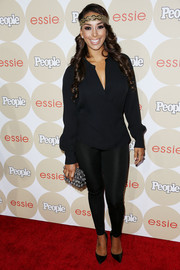 Gloria Govan opted for a casual red carpet look with a navy tunic and black leggings when she attended People's Ones to Watch party.
