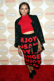 Kat Graham topped off her outfit with a tough-looking multi-buckled black jacket when she attended People's Ones to Watch party.