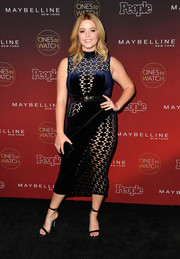 Sasha Pieterse sealed off her head-turning attire with black slim-strap heels.