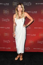 Paris Jackson opted for flat thong sandals by Sarah Flint instead of heels.