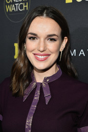 Elizabeth Henstridge wore her hair with a center part and just a slight wave at the Ones to Watch event.