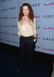 Rebecca Wisocky wore a cute nude tie-neck blouse with jeans when she attended the People StyleWatch Denim Awards.