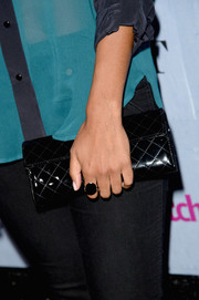 Jessica Lucas' quilted black clutch added a touch of elegance to her casual look during the People StyleWatch Denim Awards.