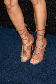 Jeannie Mai went to the People StyleWatch Denim Awards wearing ultra-sexy tan gladiator heels.