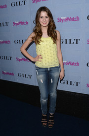Laura Marano contrasted her edgy jeans with a sweet beaded yellow blouse when she attended the People StyleWatch Denim Awards.