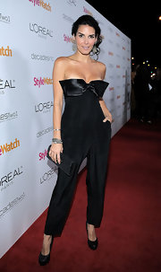 Angie dons a stylish black jumpsuit in a sleek black with a bowed bust at the People's StyleWatch party.