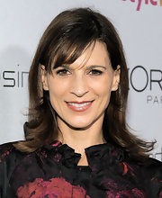 Perrey Reeves styled her tresses in a shoulder length cut complete with wispy bangs.