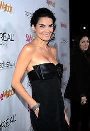 Actress Angie Harmon added a fierce touch to her look with a diamond Snake bracelet.