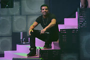 Drake couldn't look cooler in these black kicks with a printed tongue.