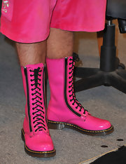 Perez Hilton bravely donned hot-pink lace-up boots (and shorts) to his book signing.