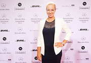 Sabine Lisicki's white blazer lightened up her dark dress.