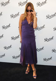 Kelly Bensimon sported a bright grape, pleated maxi while at the Persol Magnificent Obsession event.