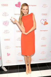 Petra was citrus perfection in this tangerine cocktail dress to celebrate her charity partnership with Clinique.