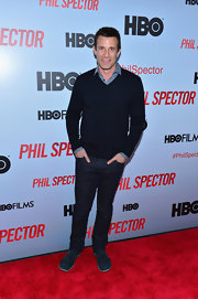 A.J. Hammer kept his red carpet look casual with a v-neck sweater paired over a button down shirt.
