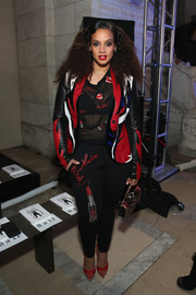 Dascha Polanco was biker-chic in a tricolor leather jacket by Philipp Plein during the brand's fashion show.