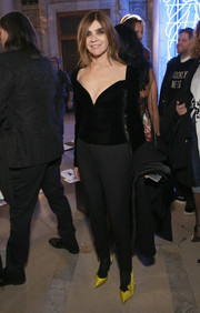 Carine Roitfeld looked ageless in a fitted black velvet top and cigarette pants at the Philipp Plein fashion show.