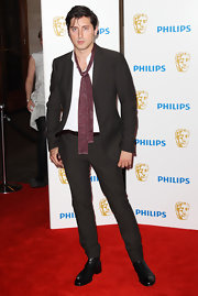 Carl Barat looked cool and sophisticated as he walked the red carpet in a pair of sleek black loafers.