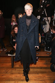 Kate Lanphear sported a long navy wool coat over her all black outfit at the Philosophy runway show.