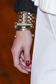 Olivia Palermo piled on the gold bangles while attending the Philosophy by Natalie Ratabesi Fall 2013 runway show.