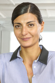 Giovanna Battaglia attended the Philosophy by Natalie Ratabesi fashion show wearing her hair in a side-parted chignon.