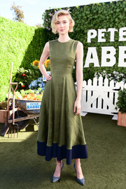 Elizabeth Debicki chose an olive-green midi dress with a contrast hem for the 'Peter Rabbit' photocall.