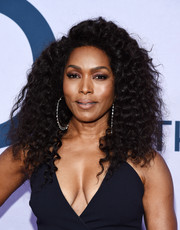 Angela Bassett jazzed up her lobes with a pair of oversized sterling hoops.