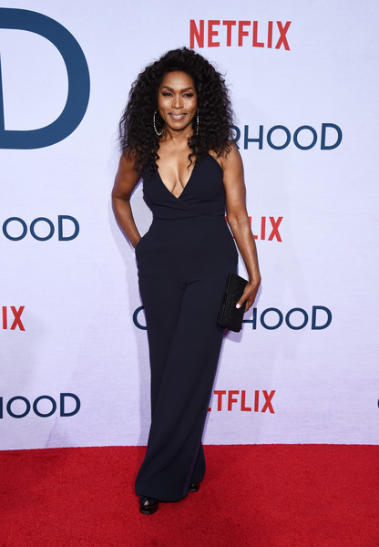 Angela Bassett matched her jumpsuit with a beaded black clutch.